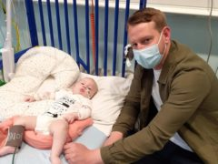 Five-month-old Arthur Morgan with his father Reece Morgan (NHS England/PA)