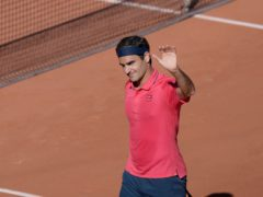 Roger Federer waves to the crowd after beating Denis Istomin (Thibault Camus/AP)