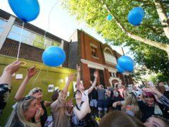 People release balloons at a vigil for Tony Eastlake (Yui Mok/PA)