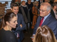 Scott Morrison (right) chats with Jacinda Ardern (left) and her partner Clarke Gayford (second from left) (Peter Meecham/AAP Image via AP/PA)