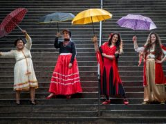 Women from the Maryhill Integration Network launch the Refugee Festival in Glasgow's Queen's Park (Paul Chappells/PA)