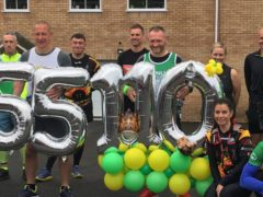 Fundraiser Gary McKee with supporters before setting off on the final marathon of his 110-day challenge (Macmillan Cancer Support/PA)