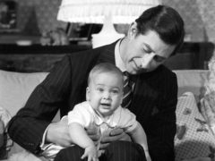 The Prince of Wales cradles his son Prince William at Kensington Palace in 1982 (Ron Bell/PA)