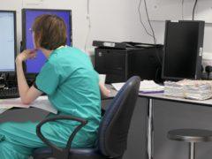 A medical professional at work at the Royal Liverpool University Hospital (PA)