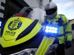 The car was equipped with flashing lights (Andrew Milligan/PA)