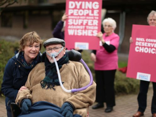 Terminally ill Noel Conway with his wife Carol outside Telford Justice Centre in Shropshire (Aaron Chown/PA)