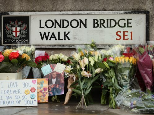 Floral tributes for victims of the attack left on London Bridge (Yui Mok/PA )