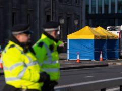 Police tents outside Fishmonger's Hall, on London Bridge, following Usman Khan's terror attack (Dominic Lipinski/PA)