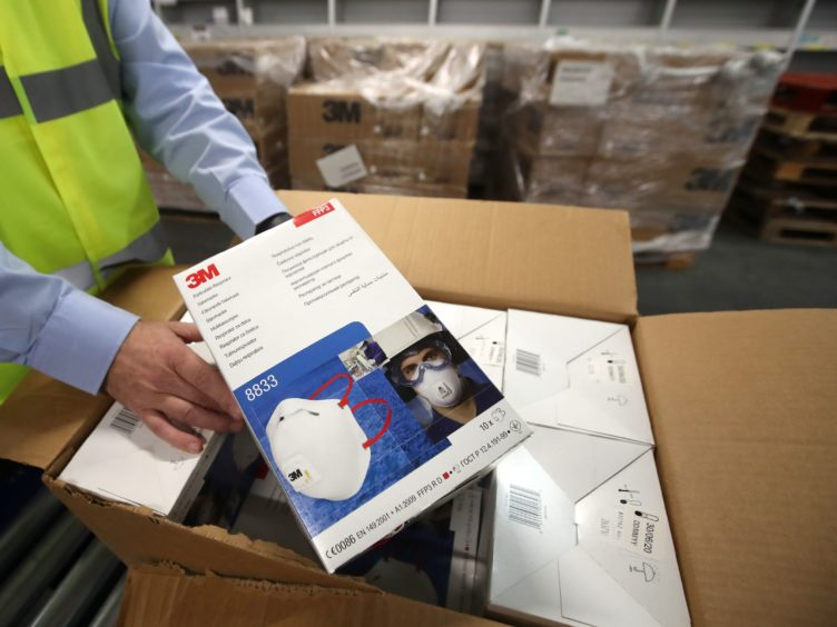 PPE stocks ran low early in the pandemic (Andrew Milligan/PA)