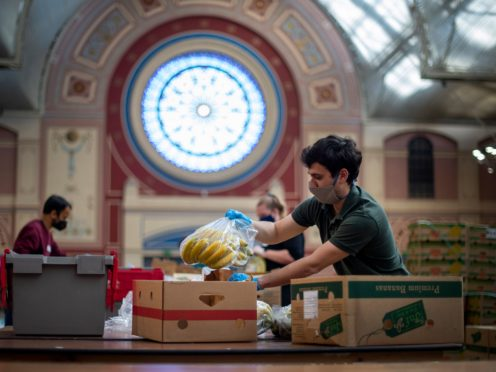 Food parcels prepared by volunteers were an important source of support during the Covid-19 pandemic (Victoria Jones/PA)