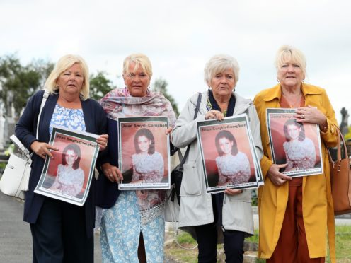 The sisters of Jean Smyth-Campbell, (left to right) Margaret McQuillan, Ann Silcock, Pat Smith and Sheila Denvir, at Milltown cemetery in Belfast (Brian Lawless/PA)