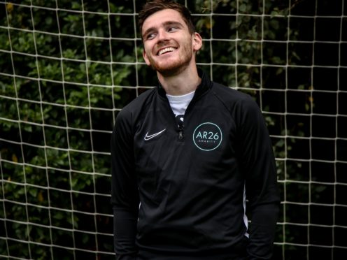 Andy Robertson gifted his team-mates a warm welcome (PA)