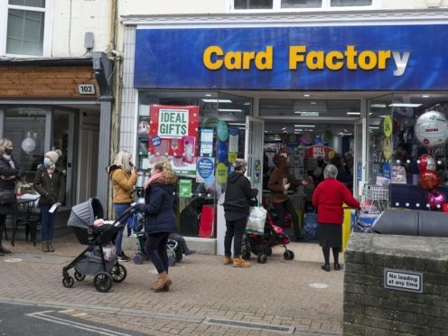 Shoppers queue for the Card Factory shop on the High Street in Newport, Isle of Wight, after the second national lockdown (Steve Parsons/PA)