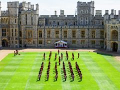 The Queen watching a ceremony in the Quadrangle of Windsor Castle (PA)