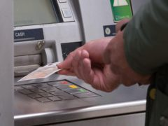 A man withdrawing money from an ATM (Aaron Chown/PA)