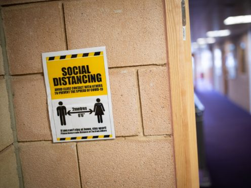 A social distancing sign (Aaron Chown/PA)