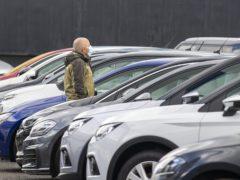 Car dealer Inchcape has upgraded profits but warned over chip shortage (Liam McBurney/PA)