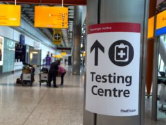 A testing area sign at Heathrow Airport (Aaron Chown/PA)