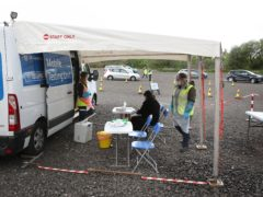 Staff from the Scottish Ambulance Service run a Covid Mobile Testing Unit in Glasgow (Andrew Milligan/PA)