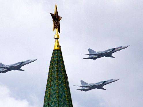 Russian Tu-22M3 bombers fly over the Kremlin's Tower with a Red Star on the top (Ivan Sektretarev/AP)