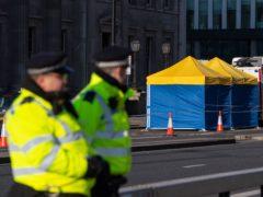 Police tents outside Fishmonger's Hall on London Bridge (Dominic Lipinski/PA)