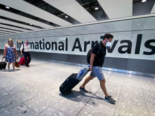 Travel bosses reacted with fury to the latest advice on travel. (Aaron Chown/PA)