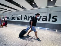 Boris Johnson has played down suggestions that restrictions on foreign travel could be lifted as more people received the coronavirus vaccine (Aaron Chown/PA)
