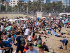 People enjoy the beach in Barcelona, Spain (Emilio Morenatti/AP)