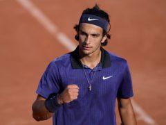 Lorenzo Musetti will take on Novak Djokovic in the fourth round (Thibault Camus/AP)