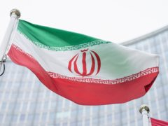 The flag of Iran waves in front of the the International Centre building with the headquarters of the International Atomic Energy Agency, IAEA, in Vienna, Austria (Florian Schroetter/AP)