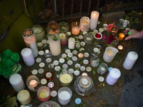 Candles at a vigil for Tony Eastlake at his flower stall (Yui Mok/PA)