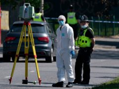 Police and forensics officers at the scene on College Road, Kingstanding, north of Birmingham (PA)