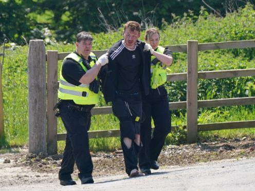A man is detained at Hallington House Farm, on the outskirts of Louth, Lincolnshire (PA)