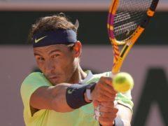 Rafael Nadal plays a return against Alexei Popyrin (Christophe Ena/AP)