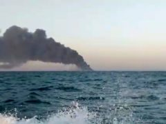 Smoke rising from Iran's navy support ship Kharg in the Gulf of Oman (Asriran.com/AP)