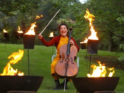 Cellist Su-a Lee performs at the Royal Botanic Garden Edinburgh to mark the programme announcement of the Edinburgh International Festival (Andrew Milligan/PA)