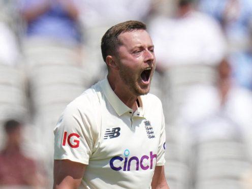 England's Ollie Robinson celebrates taking the wicket of New Zealand's Tom Latham (Adam Davy/PA)