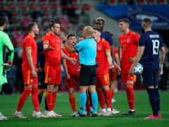 Wales captain Gareth Bale (third left) argues with the referee after Neco Williams is sent off in the friendly defeat to France in Nice (Daniel Cole/AP)