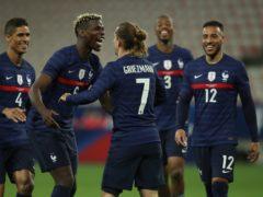 France players celebrate Antoine Griezmann (centre) scoring in their friendly win against Wales (Daniel Cole/AP)