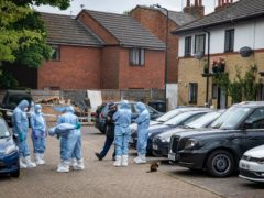 Forensics officers in Energen Close in Harlesden, north-west London, following the shooting (Aaron Chown/PA)