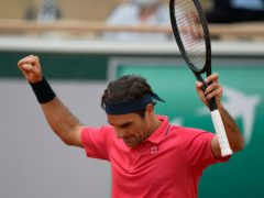 Roger Federer celebrates his victory over Marin Cilic (Michel Euler/AP)