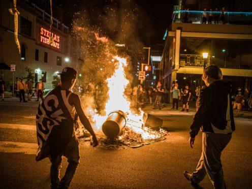 Protesters set a fire after the shooting (Richard.Tsong-Taatari/Star Tribune via AP)