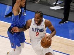 Los Angeles Clippers forward Kawhi Leonard drives past Dallas Mavericks guard Jalen Brunson (Michael Ainsworth/AP)