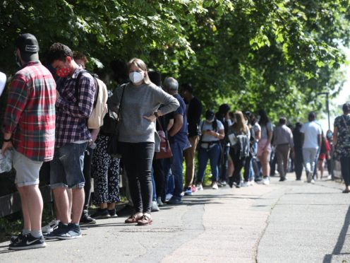 People queue to go into Belmont Health Centre in Harrow on June 5 to receive a first dose of Pfizer coronavirus vaccine (Jonathan Brady/PA)