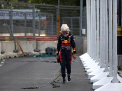 Red Bull's Max Verstappen walks off the track after crashing out five laps from the end of the Azerbaijan Grand Prix following a tyre failure (Maxim Shemetov, Pool via AP)