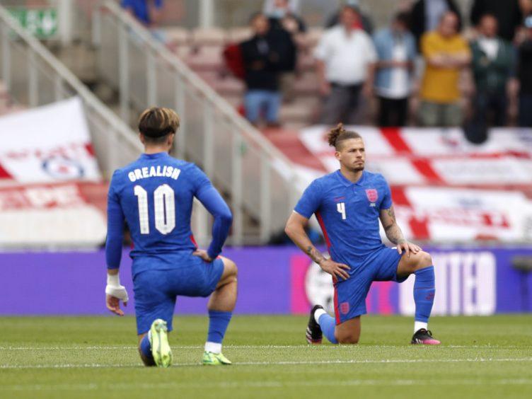 England's Jack Grealish and Kalvin Phillips take a knee (Lee Smith/PA)
