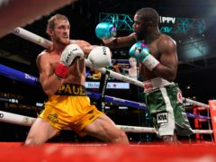 Floyd Mayweather, right, throws a punch at Logan Paul, left, during an exhibition boxing match at Hard Rock Stadium in Miami Gardens, Florida (Lynne Sladky/AP)