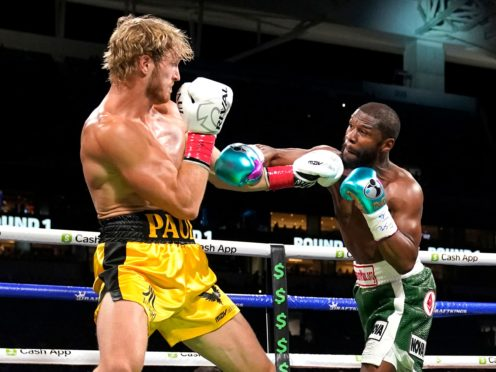 Logan Paul, left, and Floyd Mayweather fight during an exhibition boxing match at Hard Rock Stadium in Miami on Sunday (Lynne Sladky/AP)