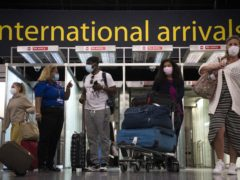 Passengers arrive at Gatwick Airport before Tuesday's 4am requirement for travellers arriving from Portugal to quarantine for 10 days comes into force (Kirsty O'Connor/PA)