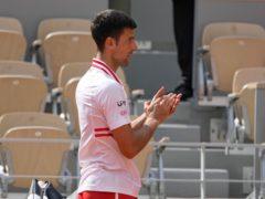Novak Djokovic applauded Lorenzo Musetti off court (Michel Euler/AP)